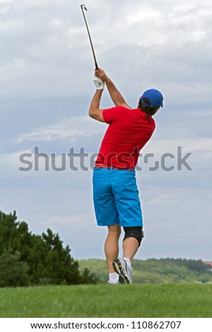 golfer swing at the ball - stock photo