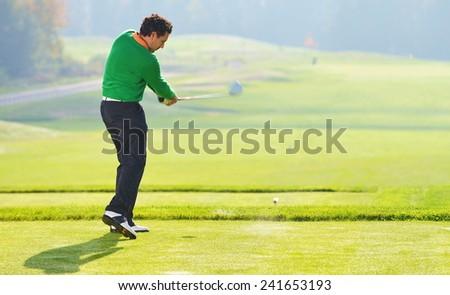 Golfer swing, teeing off on beautiful summer morning - stock photo