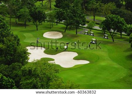 golfers playing golf - stock photo