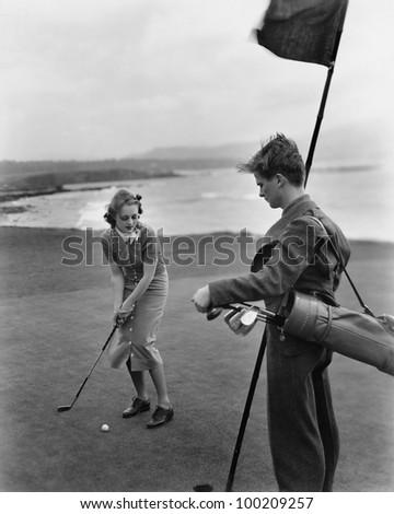 Golfing on the coast - stock photo