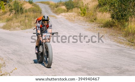 Gomel, Belarus - August 9, 2015: Mountain Bike cyclist riding track at sunny day, healthy lifestyle active athlete doing sport. Bike with fat tires. - stock photo