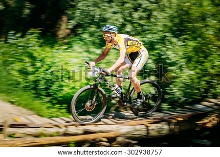 GOMEL, BELARUS - JUNE 7, 2015: Mountain Bike cyclist riding track at sunny day, healthy lifestyle active athlete doing sport - stock photo