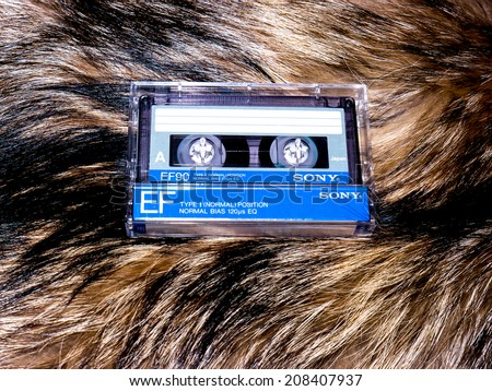 GOMEL, BELARUS-JUNE 11,2014:Sony cassette tape  on fur background. Sony Corporation, commonly referred to as Sony, is a Japanese multinational  corporation headquartered in Konan Minato, Tokyo, Japan. - stock photo