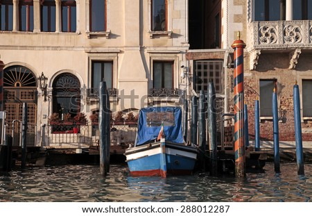 Gondola and typical medieval house on Grand canal, Venice, Italy.  - stock photo