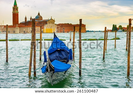 Gondola at sunset near the Piazza San Marco, Venice, Italy. - stock photo