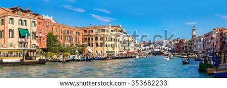 Gondola at the Rialto bridge in Venice, in a beautiful summer day in Italy - stock photo