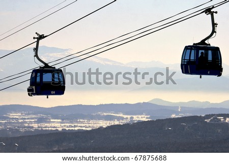 Gondola cable car for skiers and snowboarders - stock photo