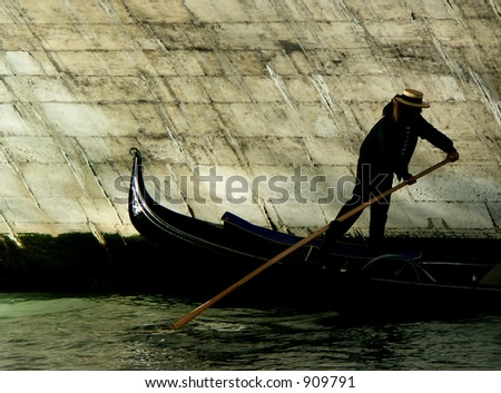 Gondola going under the Rialto Bridge, Venice - stock photo
