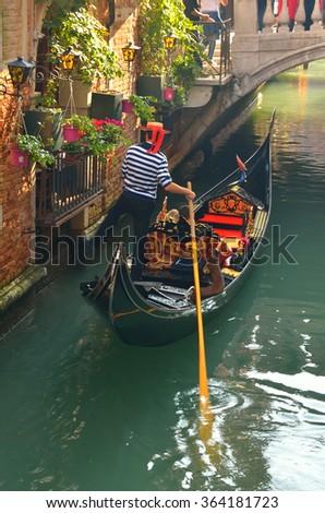 gondola in the canal in Venice - stock photo