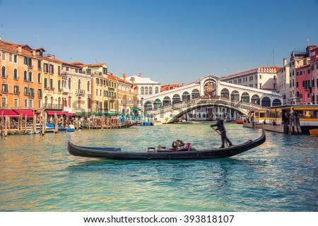 Gondola near Rialto Bridge in Venice, Italy - stock photo