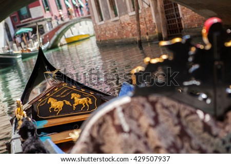 Gondola nose on water, Venice channel - stock photo
