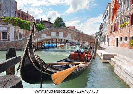 Gondola on a beautiful canal in Venice, Italy - stock photo