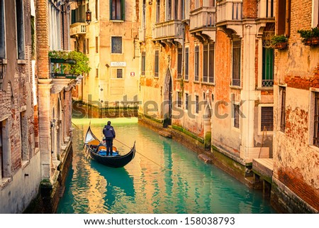 Gondola on canal in Venice, Italy - stock photo
