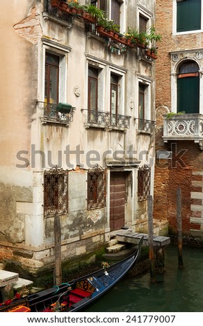 Gondola parked in Venice backyard. - stock photo