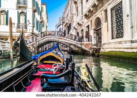 Gondolas are one of main attraction in lovely Venice. / Road with gondola is unique experience and great touristic attraction in Venice, Italy. - stock photo