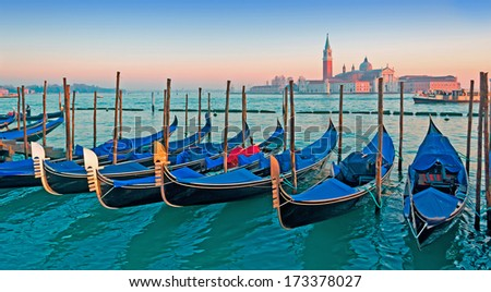 gondolas at dusk on a clear day - stock photo