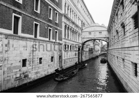 Gondolas floating on canal towards Bridge of Sighs (Ponte dei Sospiri). Venice, Italy. Perspective. Aged photo. Black and white. - stock photo