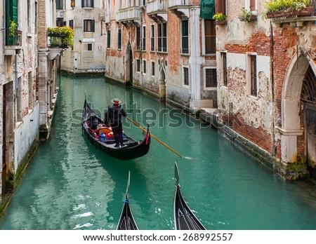 Gondolas floating on canal , venice italy - stock photo