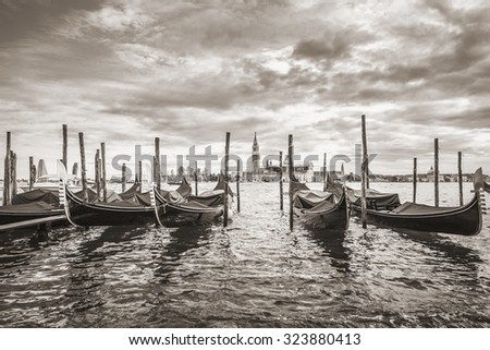 Gondolas in lagoon of Venice and San Giorgio island in background, Italy, Europe, Sepia filtered style - stock photo