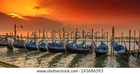 Gondolas in lagoon of Venice at sunset, Italy - stock photo