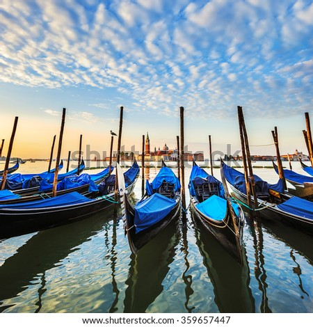 Gondolas in lagoon of Venice on sunrise, Italy - stock photo