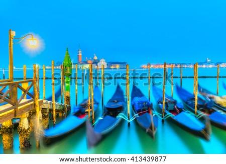 Gondolas in Venice - with San Giorgio Maggiore church. San Marco, Venice, Italy ( gondolas intentionally blurred) - stock photo