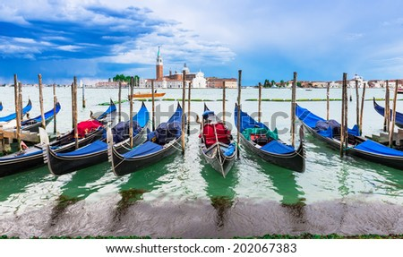 Gondolas moored by San Marco square with San Giorgio di Maggiore church in the background, Venice. Italy  - stock photo