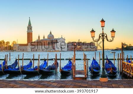 Gondolas on San Marco square with San Giorgio Maggiore island in background, Venice, Italy, on sunrise - stock photo