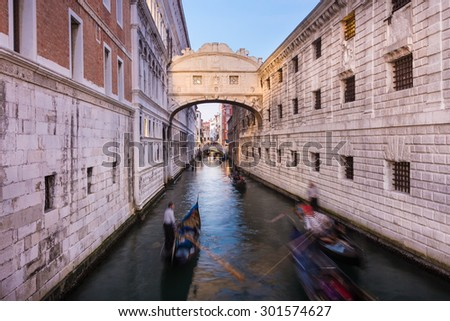 Gondolas passing under Bridge of Sighs, Ponte dei Sospiri. A legend says that lovers will be granted eternal love if they kiss on a gondola at sunset under the Bridge. Venice,Veneto, Italy, Europe.  - stock photo