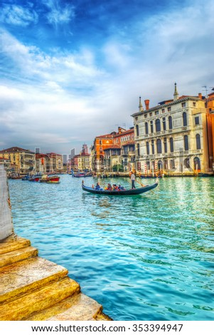 gondolier and tourists in Venice grand canal, Italy - stock photo