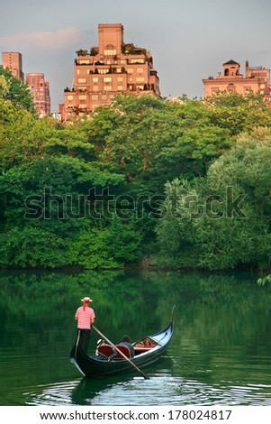 Gondolier at the lake in Central park, New York - stock photo