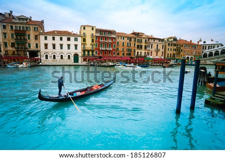 Gondolier in gondolla on the Grand canal in Venice, Itally - stock photo