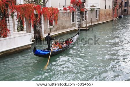 Gondolier in Venice - stock photo