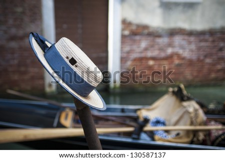 Gondolier's hat resting on post, Venice, Italy - stock photo