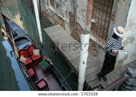 gondolier waiting for tourists - stock photo