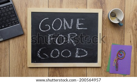 Gone for good written on a chalckboard at the office - stock photo