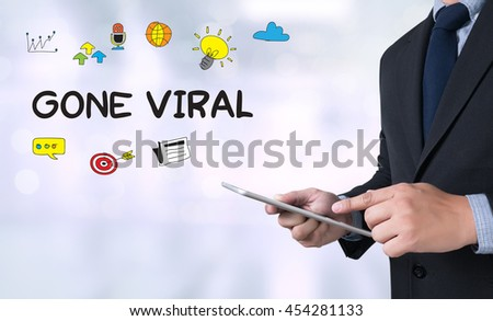 GONE VIRAL Businessman use a tablet computer - stock photo