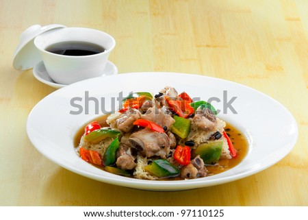 Gong Bao Chicken, a chinese dish of chicken, peanunts, spring onion, cucumber, carrot, and chilli - stock photo
