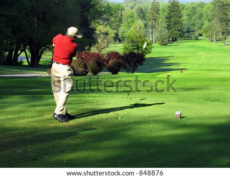 Good form sends the ball straight down the fairway - stock photo