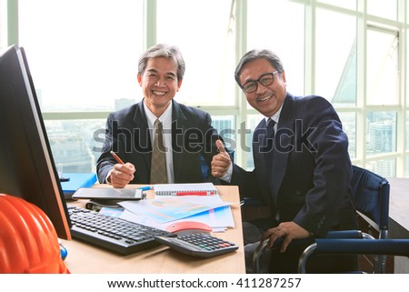 good healthy of couples friendship senior working man shot on office working table, happiness emotion, laughing face - stock photo