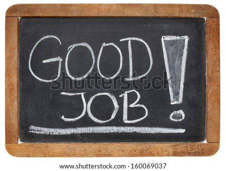 good job compliment  - white chalk handwriting on a vintage slate blackboard - stock photo
