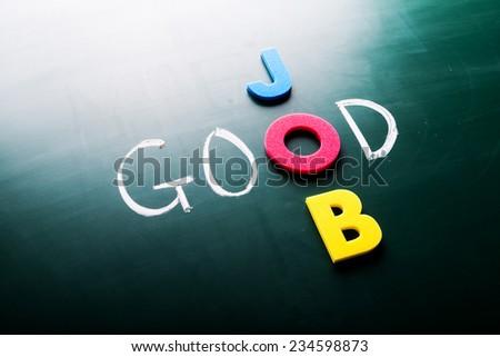 Good job concept, words on blackboard - stock photo