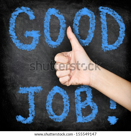 Good job - thumbs up blackboard concept. Close up of woman giving hand sign thumbs up of approval of job well done.  - stock photo
