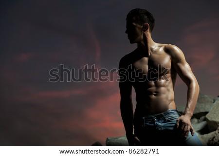 Good looking bodybuilder posing - stock photo