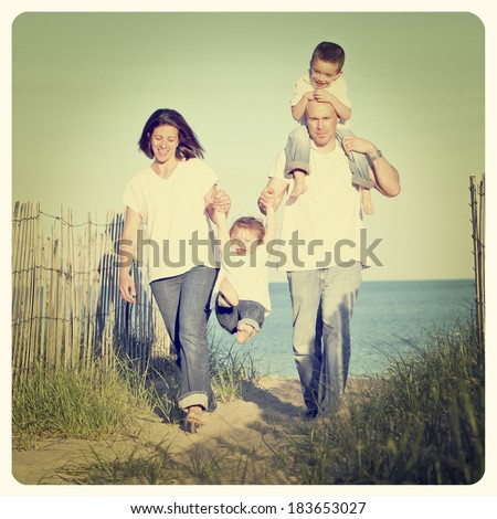 Good looking family going for a walk at the beach with Instagram effect filter - stock photo