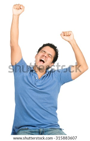Good looking latino man in blue casual clothes, eyes closed, celebrating a winning team or goal or event by raising arms and pumping fists expressing ecstasy, happiness, winning - stock photo