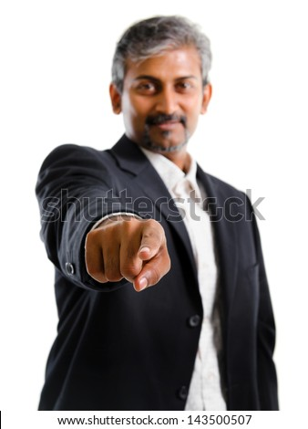 Good looking mature Asian Indian business man with business suit finger pointing at you, focus on finger, isolated on white background. Portrait of handsome Indian male model. - stock photo