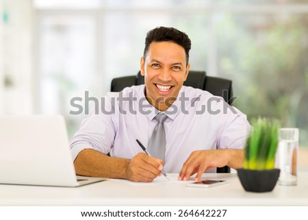 good looking mid age business executive working in office - stock photo