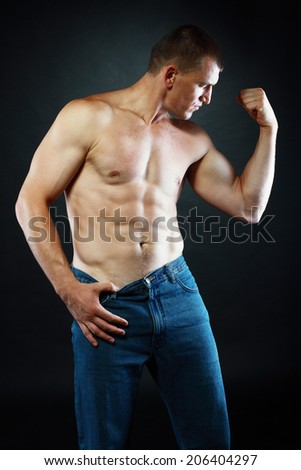good looking muscular man with his top of showing off his great body  - stock photo