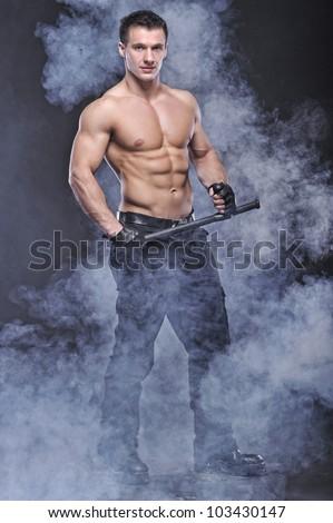 Good looking policeman bodybuilder posing - stock photo